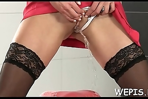 Agile girl is masturbating her juicy slit and pissing